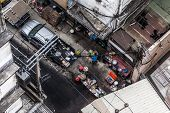picture of peddlers  - poor hawkers frying food in a crossroads of bangkok thailand - JPG