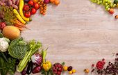 pic of eatables  - studio photography of different fruits and vegetables on wooden table - JPG