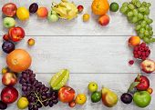 stock photo of eatables  - studio photography of different fruits and vegetables on wooden table - JPG