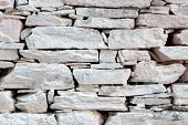 foto of fieldstone-wall  - Old wall build with flagstones and painted white - JPG
