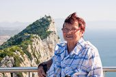 picture of gibraltar  - Portrait of happy senior woman tourist at the Rock of Gibraltar - JPG