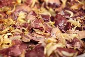 pic of liver fry  - Closeup of chicken liver being roasted in the frying pan with white onions - JPG