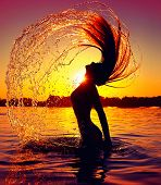 picture of long beach  - Beauty Model Girl Splashing Water with her Hair - JPG