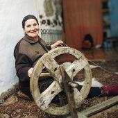 Smiling Senior Working On Loom