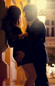 foto of provocative  - Man and woman kissing at night on the street