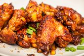 picture of chicken wings  - Closeup of caramelized asian chicken wings with selective focus - JPG