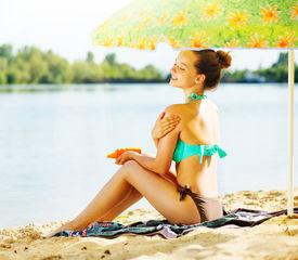 image of sun tan lotion  - Suntan Lotion Woman Applying Sunscreen Solar Cream - JPG