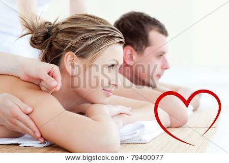 Attractive young couple having an acupunctre therapy against heart