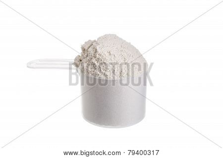 Measuring Spoon For Milk Whey Protein. On A White Background.