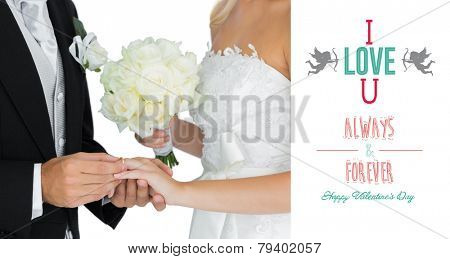 Young bridegroom putting on the wedding ring on his wifes finger against cute valentines message
