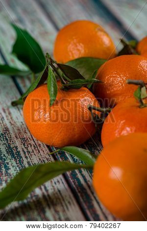 Close View On Fresh Organic Clementines On Rustic Blue Table