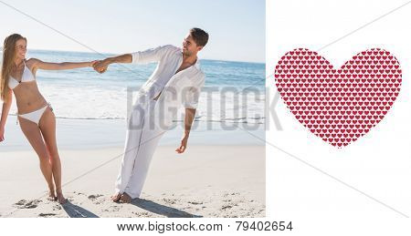 Couple holding hands and leaning to either side against valentines day pattern