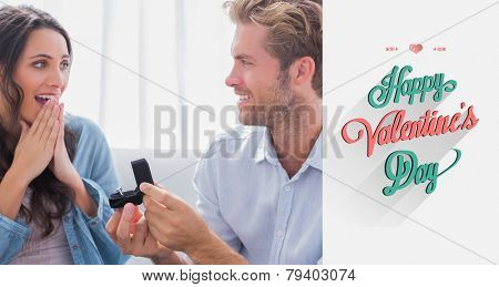 Man asking his partner to marry him against valentines day greeting