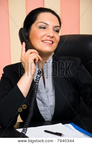 Portrait Of Formal Businesswoman Talk By Phone