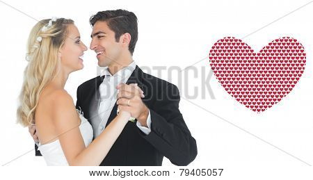 Sweet married couple dancing viennese waltz against valentines day pattern