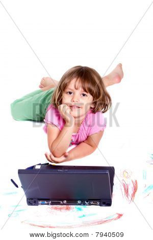 Cute Girl With Laptop And Crayons