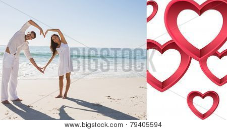 Loving couple forming heart shape with arms against pink hearts