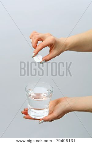 Glass With Water And Tablet in  hands
