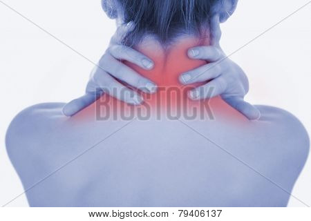 Closeup of topless woman massaging neck over white background