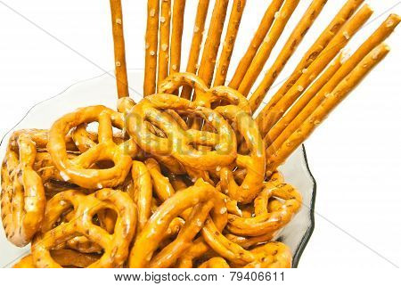 Tasty Salted Pretzels And Breadsticks On A Plate