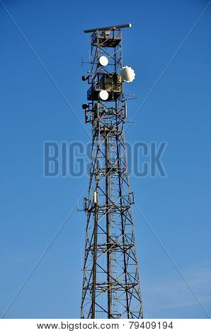 Telecommunications mast with blue sky