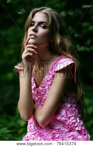 Hot Blond Woman In Pink Dress In Forest