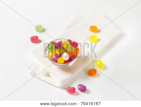 fruit jelly beans in the glass bowl with fabric linen
