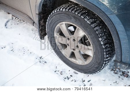 Modern Automotive Wheel With Studded Tires