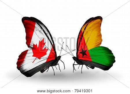 Two Butterflies With Flags On Wings As Symbol Of Relations Canada And Guinea Bissau