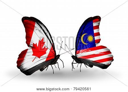 Two Butterflies With Flags On Wings As Symbol Of Relations Canada And Malaysia
