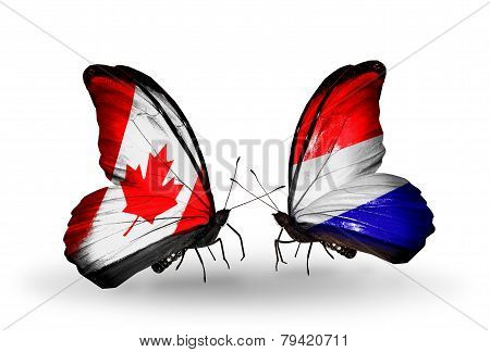 Two Butterflies With Flags On Wings As Symbol Of Relations Canada And Holland