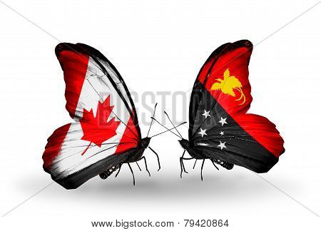 Two Butterflies With Flags On Wings As Symbol Of Relations Canada And Papua New Guinea