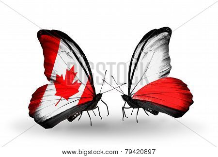 Two Butterflies With Flags On Wings As Symbol Of Relations Canada And Poland
