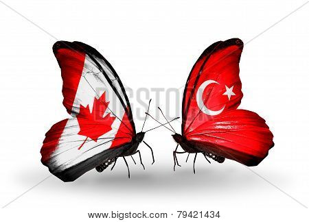 Two Butterflies With Flags On Wings As Symbol Of Relations Canada And Turkey