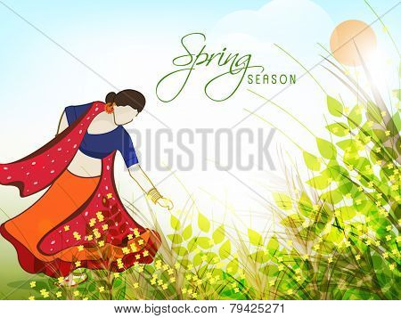 Young Indian women in traditional outfits plucking yellow flowers in sunny day, Beautiful spring season concept.