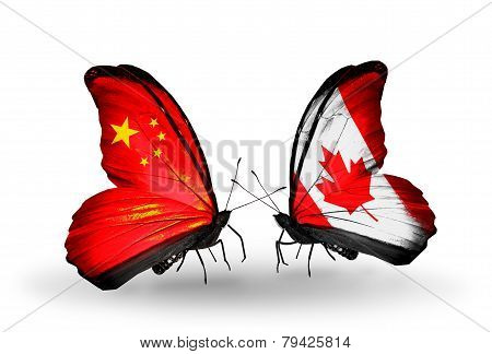 Two Butterflies With Flags On Wings As Symbol Of Relations China And Canada