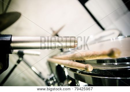 Professional Microphone Placed Close To Drums With Sticks