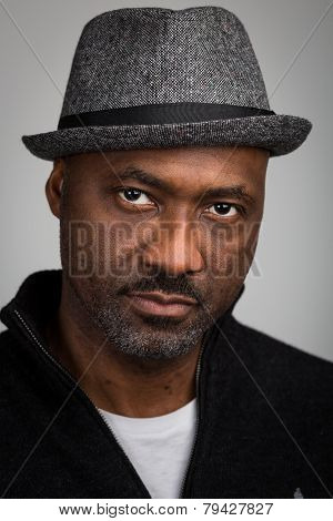 Black Man With Stubble Wearing A Hat
