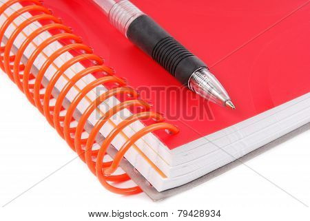 pen and notebook closed