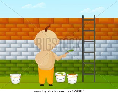 Religious Hindu boy painting wall in national flag colors for Indian Republic Day celebrations.