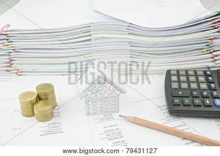 House Near Gold Coin On Balance Sheet