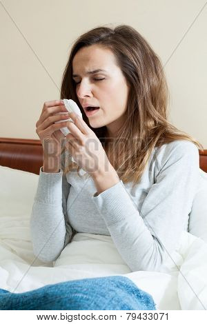 Woman Sneezing In Bed