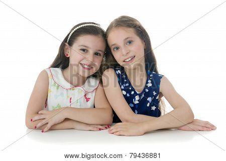 Two Beautiful Young Girls Posing For Photo