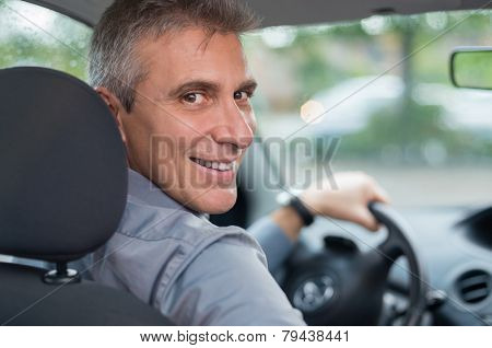 Portrait Of A Happy Mature Businessman Driving Car To Go To Work