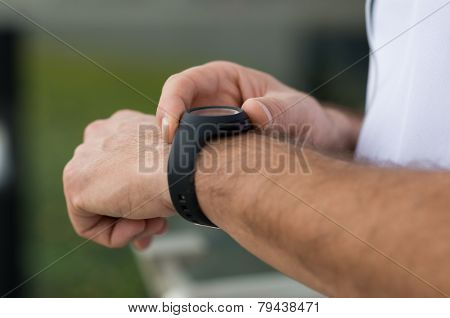 Closeup Of Man Measuring Pulse After Running