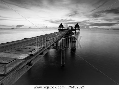 The Long Bridge Over The Sea With A Beautiful Sunrise In Black And White, Thailand