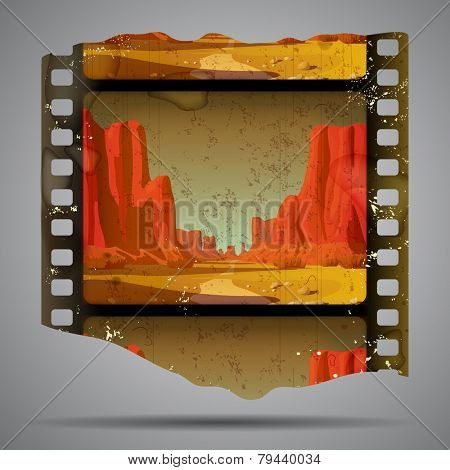 Fragment of vintage western film strip with big canyon