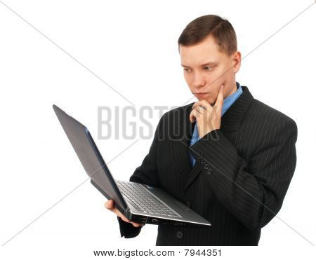 Businessman Thinking Over His Laptop Computer