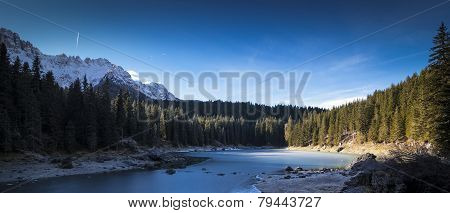 Carezza Lake In Winter With Frosty Surface