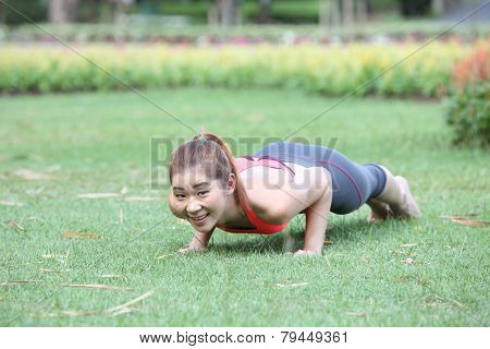 Exercise Woman Doing Push Ups In Outdoor Workout Training. Asian Sport Fitness Woman Smiling Cheerfu